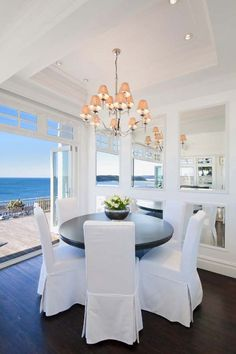 Main House Guest Casual Dining Area all white + ocean views; a great way to start the day.