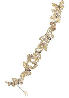 Рой золотых бабочек с ажурными крылышками, украшенными цветными бриллиантами и желтыми сапфирами, образует…