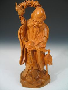 Chinese Carved Wood Figure of Shoulao. Ht 23 cm.