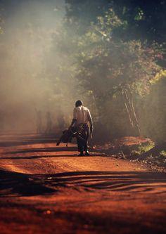Walking along road by Jesse Tamski (Rwanda)