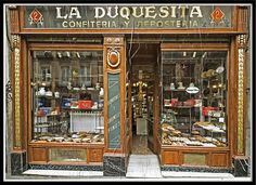 La Duquesita is a charming shop in Madrid, Spain, which sells cakes and is located near the Alonso Martínez metro station Storefront Signs, Housing Works, Shops, Shop Fronts, Gaudi, Beautiful Architecture, Store Design, Barcelona, Facade