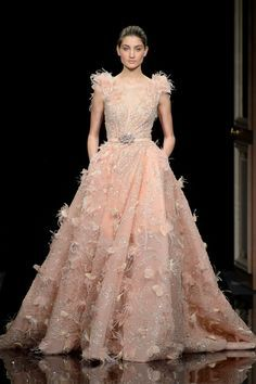 This blush dress is sprouting fluffy feathers! Focusing mostly on the shoulders, the light airy texture adds volume without adding too much weight! | WedLuxe Magazine | #Wedding #luxury #weddinginspiration #luxurywedding #couture #SS2017 #fashion #bridal #bridalfashion #fashionweek #weddinggown #weddingdress