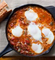 Shakshouka (Arabic: شكشوكة‎; Hebrew: שקשוקה) (also shakshuka) is a dish of eggs poached in a sauce of tomatoes, chili peppers, onions, often spiced with cumin.[1] It is believed to have a Tunisian origin