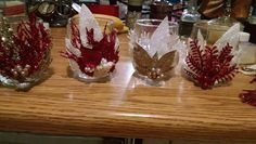 Hot glue some leaves and glasses...beauty candles!