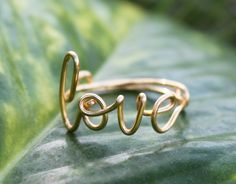 Gold Wire Love Ring Adjustable Fit Most Size by FabulousWire. $12.99 USD, via Etsy.