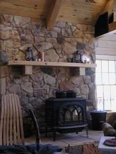 wood stove with mantle and stone surround