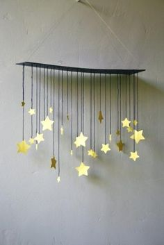 Want to adapt this concept for floating shelves in nursery. Raining Stars Mobile by shopprettythings on Etsy