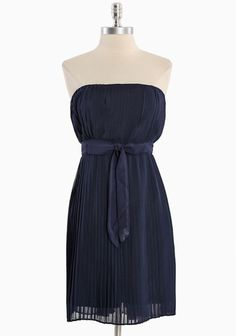 """New Classic Pleated Dress In Navy 48.99 at shopruche.com. Effortlessly elegant, this sophisticated chiffon dress in navy  features delicate pleats for graceful movement and texture, an  elasticized smocked back, and an optional waist-defining sash. Fully  lined.100% Polyester, Imported, 30"""" length from top of bust"""
