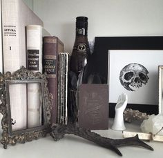 Bedroom decorations - vintage picture frame, old books, skull drawing.