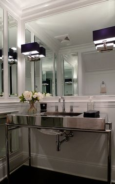 Powder Room - Stainless, mirrors, paneled walls and black shaded wall sconces....this is glam!