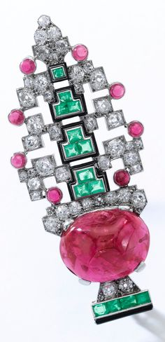 Cartier - An Art Deco ruby, emerald, enamel and diamond brooch, 1920s. Set with cabochon rubies, calibré-cut emeralds, circular- and single-cut diamonds, signed Cartier, numbered. #Cartier #ArtDeco #brooch