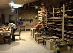LOVE all the shelves!  Pottery Studio