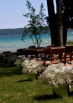 Backyard wedding on Crystal Lake in Northern Michigan with baby's breath in galvanized buckets