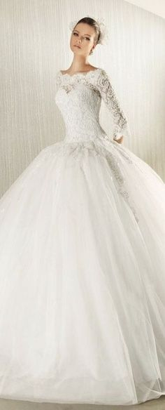 How pretty is this? Love the whole lace and huge poofy aspects of the dress