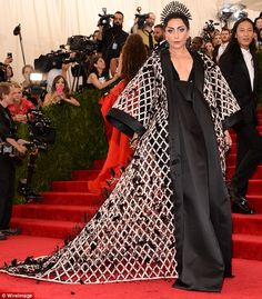 Lady Gaga dons peacock headpiece and textured monochrome at Met Gala #dailymail