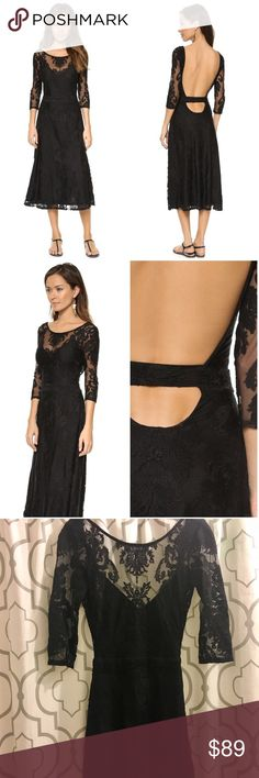"""For Love & Lemons Black Lace Backless Dress For Love & Lemons San Marcos Maxi Dress. Embroidered mesh brings a sense of gothic romance to this dress. Flared hem and alluring open back. Hidden side zip. 3/4 sleeves. Lined. Shell: 40% polyamide/40% cotton/20% polyester. Lining: 87% polyester/13% spandex. Dry clean. Approx 46.5"""" long. Tear on back (pictured). Looks easily fixable, but I'm a terrible seamstress 🤷🏻♀️  On here to declutter, 🚫 trades. If I want something in your closet, I'll…"""