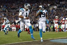 Cam Newton #1 of the Carolina Panthers celebrates as Ted Ginn Jr. #19 scores a touchdown in the first quarter against the Arizona Cardinals during the NFC Championship Game at Bank of America Stadium on January 24, 2016 in Charlotte, North Carolina. (Jan. 23, 2016 - Source: Streeter Lecka/Getty Images North America)
