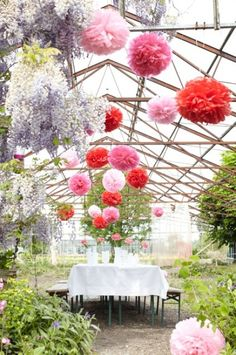 Not crazy about the pom poms, but a green house would be a lovely spot for a wedding.
