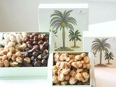 ザ・カハラのチョコレートマカダミアナッツ。中央は、ホワイトチョコにミルクキャラメルをミックスした新作の「ブロンドチョコレートマカダミアナッツ」