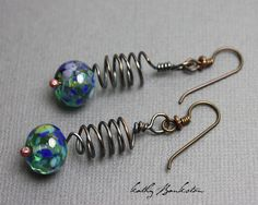 These lampwork earrings feature two Blue Green lampwork beads that were handmade in my studio. The beads have been wire wrapped using recycled copper wire. The copper has been oxidized and polished fo