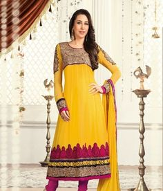 Bollywood actress Karishma Kapoor in Yellow & Rani Colour Designer Salwar Suit