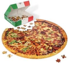 This pizza JIGSAW PUZZLE ($18).   27 Legit Cool Gifts That Look Like Pranks