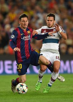 Lionel Messi of Barcelona and Juan Bernat of Bayern München battle for the ball during the UEFA Champions League Semi Final, first leg match between FC Barcelona and FC Bayern München at Camp Nou on May 6, 2015 in Barcelona, Catalonia.