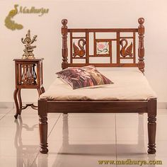 "Wooden Bed  Add to the Traditional look of your bedroom and feel Royal. This beautiful single cot made in Seasoned Teak wood takes you back to the era where India was called the ""Golden Bird"" . Our range of heritage furniture. Check out more at http://www.madhurya.com/furniture-online/low-seater-diwan.html Click like if seems awesome  #furnitureonlineindia   #antiquefurniture"