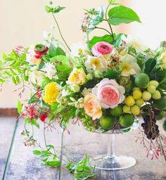 Rambling floral arrangement with citrus