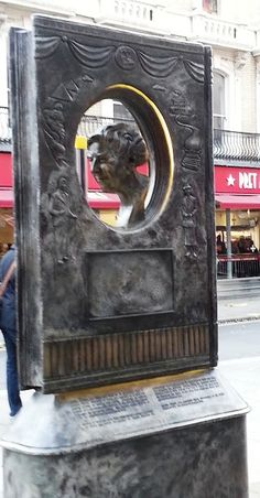 Bronze sculpture of Agatha Christie has occupied a spot at the end of Cranbourn St in London's West End. stands at 2.5 metres high and has the sideways profile of a book, with a cut-out oval section at the centre which features a bust of Christie in profile. It is also studded with effigies of her most popular characters and scenes from her novels – Hercule Poirot, Miss Marple and the Orient Express all appear.  1