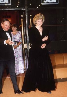 Princess Diana in a black Bruce Oldfield velvet dress worn for an official portrait by Lord Snowdon and at the gala opening of Les Miserables in 1985.