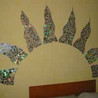 use CDs for mosaics...I've done it on bowling balls, never thought about it on the wall!