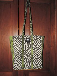 "JUNGLE MEETS GARDEN  BROWN ZEBRA GREEN GLORAL PRINT SHOULDER SATCHEL TOTE BAG This satchel tote sports braided shoulder straps and can be used as a beach bag, shopping tote or book bag.  It measures approximately 16"" wide at the opening with a 15"" shoulder drop.  Total length of bag ..."