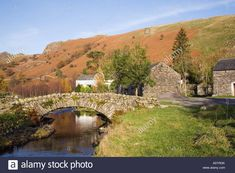 Old stone arch packhorse bridge over Watendlath beck in Lake District National Park Watendlath, Cumbria, England, UK. Stock Photo