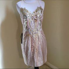 NWT Stunning Sequence Bebe Dress Gorgeous dress. Brand new. Gold sequence is beautiful. It does not have pink sequence as the pics show. Definitely a showstopper! Perfect for holidays. bebe Dresses Mini