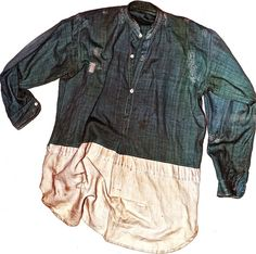 This chambray shirt from the same period has been extended with the addition of two layers of fabric, a flannel and a poplin – the stripes on the extension have even been aligned with those on the original shirt. This garment is also notable for the fine darning which complements the white stitching upon the seams.