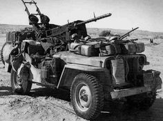 A formidable fire power, British SAS jeep. On this jeep, they have mounted twin Vickers in the back and a cal where the passenger sits. The driver has an extra mounted machine gun - most likely a single Vickers. Military Jeep, Military Weapons, Military Vehicles, Jeep Vehicles, Military Photos, Military History, Afrika Corps, Special Air Service, Willys Mb