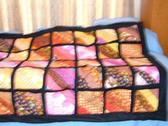 This is a throw for Amy my neighbor who is very very good to me and my husband...quilt as you go quilt never do it again....LOL