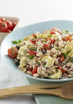 Mediterranean Bean Salad — Bring a bowlful of color to your Healthy Living plan. Food should look as good as it tastes, and this salad of beans, veggies and cheese delivers in every way.
