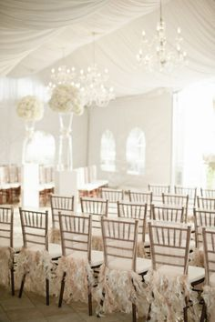 Love the seat skirts, the chandeliers, the draping... Ok I love everything about this.