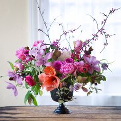 Spring garden flowers, in purples, peach, pink....clematis, fritillarias, flowering branches, by Tulipina
