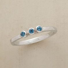 THREE WISHES RING--The three sparkling stones of this London blue topaz ring promise health, happiness and love. Hand-hammered sterling silver band. Exclusive. Whole sizes 5 to 9.