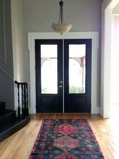 Black Stairs and a New (Old) Rug - Juniper Home Grey Paint Colors, Wall Colors, Black Stairs, Little Green Notebook, Foyer Decorating, Black Doors, Outdoor Rugs, Decoration, Interior Design