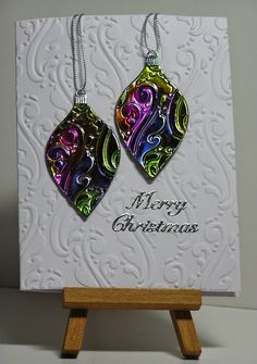 Alcohol ink on a metal sheet and trough the cuttelbug with an embossingfolder. Base card is the same embossingfolder.