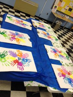 It is a Daisy, after the founder of Girl Scouts.    It was made using our right hands, the hand we use for our promise sign.    Each color on the shirt is intended to represent one of the ten Girl Scout Laws.    The leader's hands are the stem of the flower.    The circle in the center was a creation of the girl herself, because our individuality is at the center of what makes our troop whole.