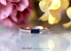 0.55 ct.tw Minimal Solitaire Blue Baguette Cut Engagement Ring-Wedding Ring-Stackable Ring-Rose Gold Plated-Sterling Silver [52350RG-BL] by Besbelle on Etsy https://www.etsy.com/listing/471324475/055-cttw-minimal-solitaire-blue-baguette