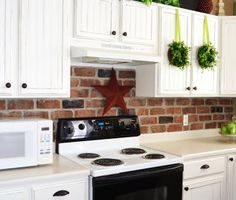 how-to: brick veneer for back-splash and bead board added to dated oak cabinets then painted white.