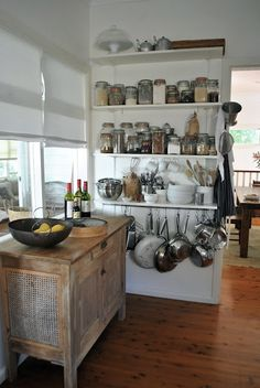 "Kitchen organization  Who would have ""thunk"" an open pantry could be so wonderful. By limiting storage to jars containing dry goods, everyday china, pots and frequently used utensils, the space stays neat and becomes an architectural element to an unfitted kitchen."