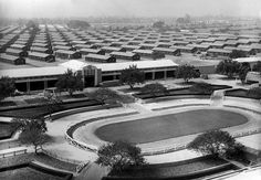 The Santa Anita Park race track is converted into an internment camp for evacuated Japanese Americans who will occupy the barracks erected in background in Arcadia, California. Photo taken on April 3, 1942.