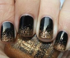 gold sparkle over black nail polish